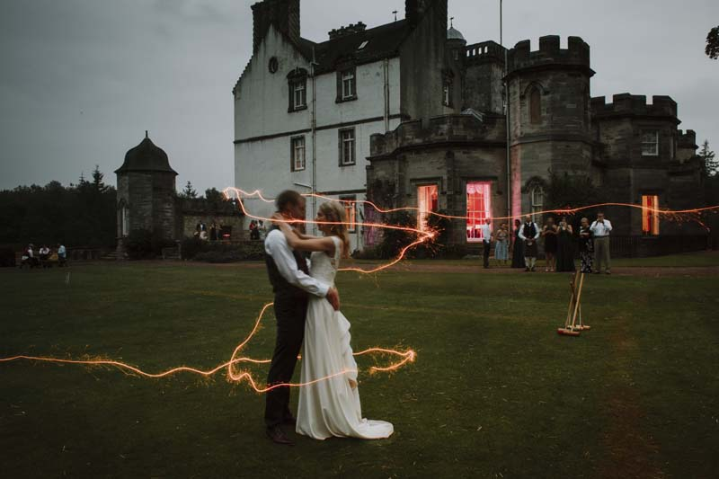 Wedding couple outside Winton Castle