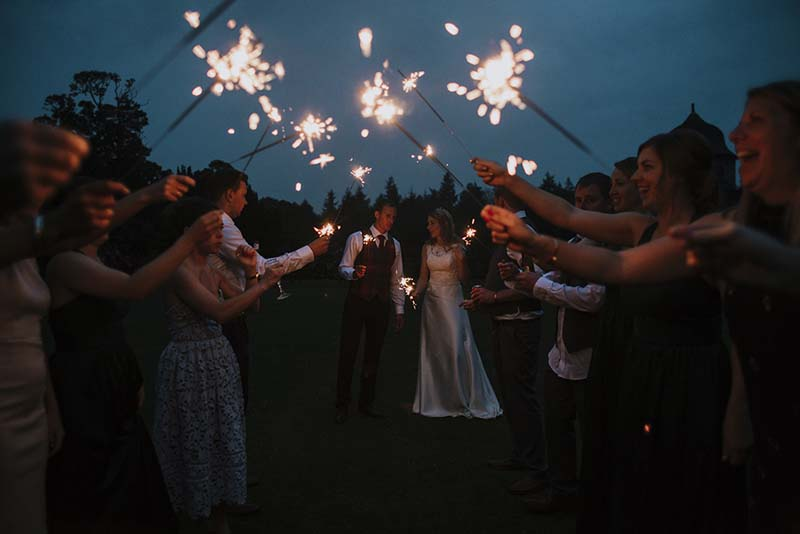 Wedding Guests with Sparklers at Winton Castle